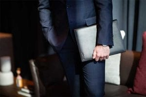 arcis business professional with folio in suit